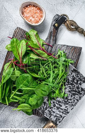 Fresh Mixed Greens, Spinach, Swiss Chard And Arugula. White Background. Top View
