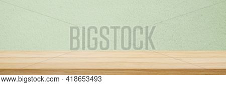Wood Table And Green Wall Background In Kitchen, Wooden Shelf, Counter For Food And Product Display