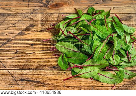 Fresh Raw Chard Leaves, Mangold, Swiss Chard On A Wooden Kitchen Table. Wooden Background. Top View.
