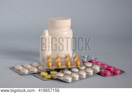 Different Medicines- Tablets And Pills In Blister Pack, Medications Drugs And White Plastic Medical