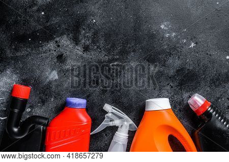 Home Cleaning Concept, Housecleaning, Hygiene, Spring, Chores, Cleaning Supplies. Black Background.