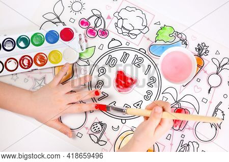 The Child Drew And Painted His Nails With Paint. Funny Picture. On A White Background Near A Brush O
