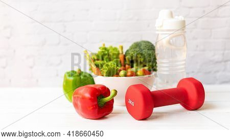 Close Up Dumbbell.  Diet Health Food And Lifestyle Health Concept. Sport Exercise Equipment Workout