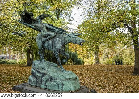 Copenhagen, Denmark - Oct 19, 2018: Bronze Statue Of The Valkyrie In The Tranquil Churchill Park; An