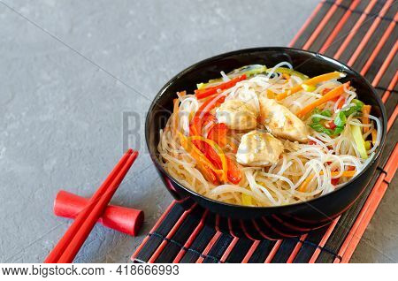 Asian Salad With Glass Noodles, Chicken And Vegetables - Carrots, Bell Peppers And Sesame Seeds On A