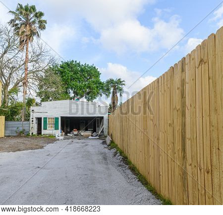New Orleans, La - April 19: Driveway To Old Beat Up Garage And New Wooden Fence On April 19, 2021 In