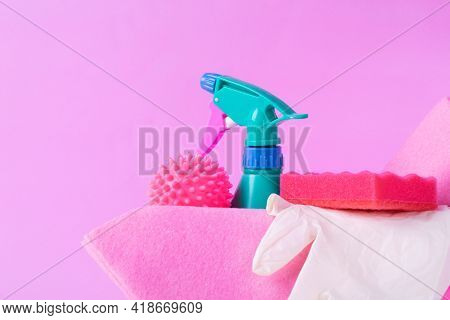 Cleaning Set On Pink. Spray Bottle, Laundry Ball, Sponge, Rag And Latex Gloves In Crate. Housekeepin