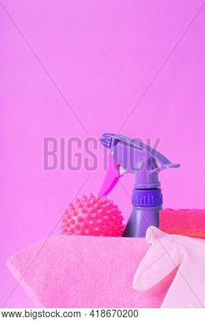 Cleaning Set On Pink. Spray Bottle, Laundry Ball, Sponge, Rag And Latex Gloves. Housekeeping Tools.