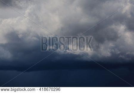 Dark Storm Clouds Before Rain. Storm Cloud Background Before Rain. Dark Clouds. Huge Black Clouds. C