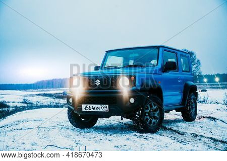 Moscow, Russia - January 24, 2020: New Suzuki Jimny Mini Suv On A Winter Road In The Evening. Japane