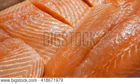 Salmon Fish On Ice, Fresh Raw Fillet Chilled, At The Fish Market.