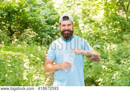 Guy Maintains Body Water Balance. Hydration. Daily Water. Brutal Bearded Man Drink Bottle.