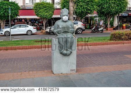 Alanya, Turkey - October 23, 2020: Medical Mask Worn On The Face Of A Stone Sculpture Of A Man With