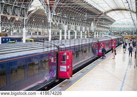 London, Uk - March 17, 2020 - Passengers Boarding A Train At London Paddington Station