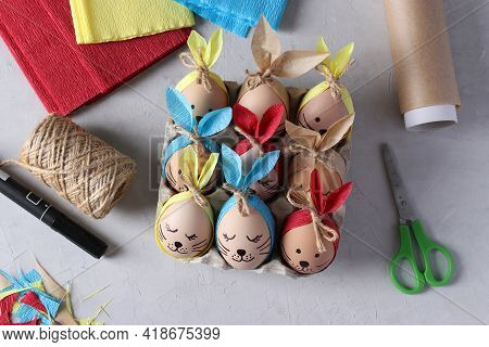Decorate Eggs For Easter Using Colored Paper And Parchment In The Form Of Rabbits. We Tie The Cut St
