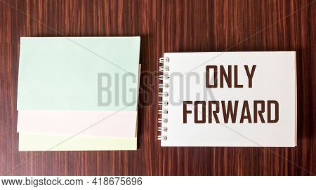 Only Forward. Motivational Quote Written On A White Notepad And Wooden Background. Positive Vibes On