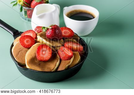 Homemade Small Pancakes With Strawberry Served In Pan Yellow Background Fresh Pancakes And Cup Of Co