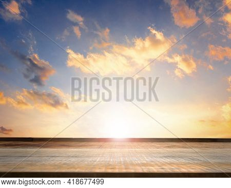 Empty Top Of Wooden Table And View Of Sunset  Background