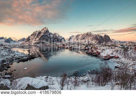 Viewpoint Of Reine Village With Snow Mountain Range On Coastline At Lofoten Islands, Norway