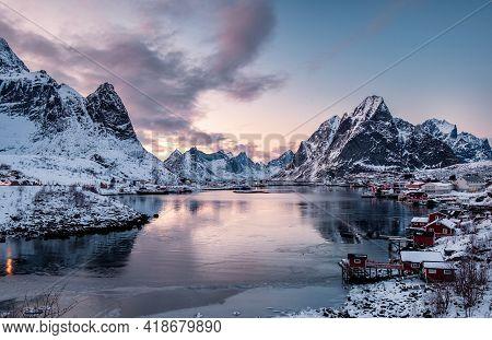 Landscape Of Scandinavian Village In Valley On Coastline At Sunset, Reine, Lofoten, Norway