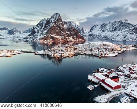 Aerial View Of Fishing Village In Surrounded Mountain On Winter Season At Reine, Lofoten Islands, No