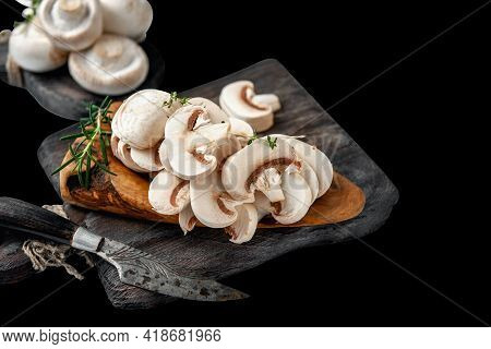 Natural, Organic Mushrooms On A Vintage Wooden Table. Sliced Slices Of Fresh Raw Mushrooms Porcini M