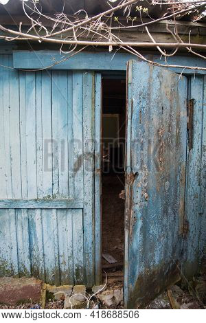 Entrance To An Old Abandoned Building. There Are Traces Of Desolation Everywhere. Destruction And Ab