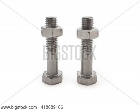 Front View Of Two Bolts With Hex Nuts On White Background. Close Up Of Hardware Store Parts. Diy Ute