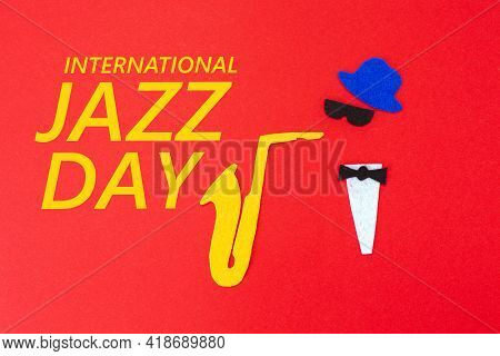 Silhouette Of A Musician With A Saxophone From Which Melodies Flew Out, On A Red Background, Cutted