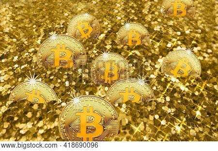 Shiny Bitcoins Cryptocurrency Pieces Are Almost Buried In A Large Pile Of Shiny Gold Pieces