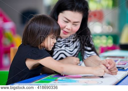 Mom Gave Her Daughter Some Advice For Making Crafts. Doing Activities Together In The Family. Girl H
