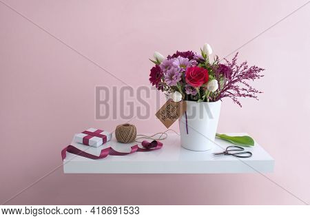 Mothers Day Flowers With Greeting Card On A Floating White Shelf, Interior Design Background