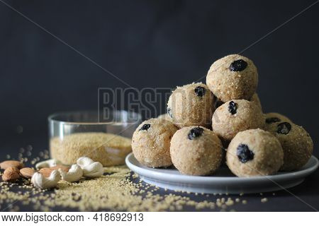 Ball Shaped Indian Sweet Made With A Mixture Of Foxtail Millet Flour, Sugar, And Shortening. Locally