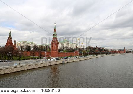 View Of The Moscow Kremlin, The Grand Kremlin Palace And Moscow River On Cloudy Sky Background. Scen