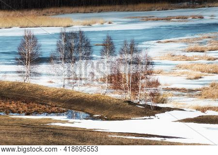Melting Snow On The Lake In Early Spring. Trees On The Shore Of Lake. Beautiful Spring Landscape. So