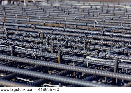 Construction Rebar Steel Work Reinforcement. Reinforcements Steel Bars Stack. Close Up Steel Constru