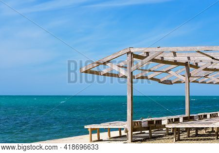 Sun Loungers And A Wooden Shed On The Old Pier By The Sea. Bright Blue Sky And Calm Sea, Sea View Va