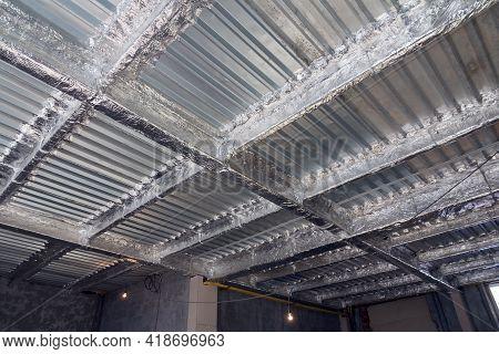Foil Insulation. Insulation Of The Steel Frame Of The Building With Insulation With Foil. Insulation