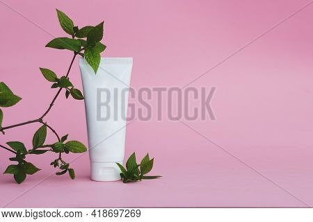 Cream Tube On Pink Background. Cosmetic Skincare Product Blank Plastic Package. White Unbranded Loti