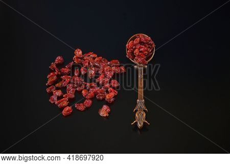 Organic Anardana Or Sun Dried Seeds Of Pomegranate Fruit On Black Background In Vintage Cooper Orien