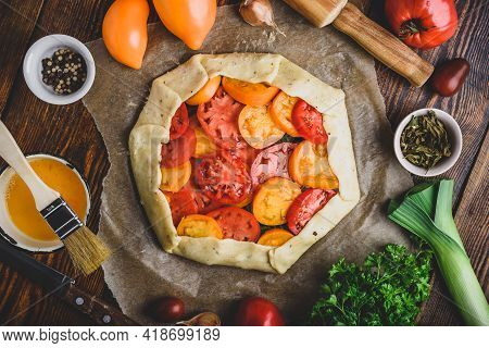 Uncooked Tomato Galette On Baking Paper. View From Above