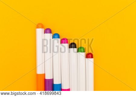 Colorful Highlighter Text Markers Isolated On Yellow