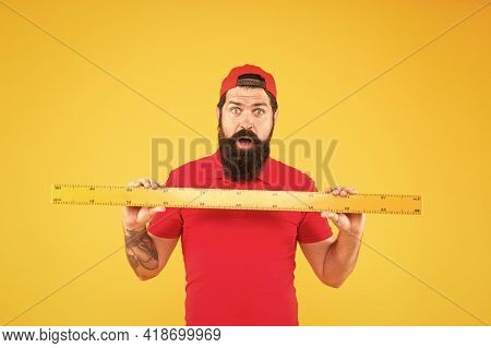 Without Geometry Life Is Pointless. Surprised Hipster Hold Ruler Yellow Background. Geometry Lesson.