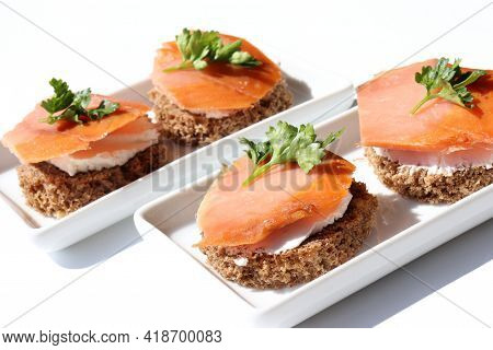 Smoked Salmon Canapes On White Bread With Cream Cheese And Parsley. Sandwich With Salmon On White Ba