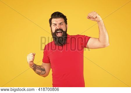 I Made It. Happy Hipster Yellow Background. Successful Hipster Show Winning Gesture. Victory. Bearde