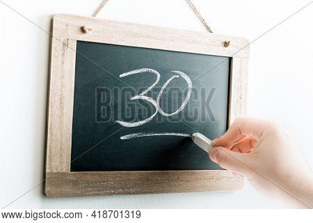Number 30 Handwritten With Chalk On A Blackboard
