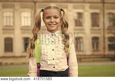 Back To School. Happy Child Outdoors. Little Child Smile In School Uniform. Small Child Wear Long Wa