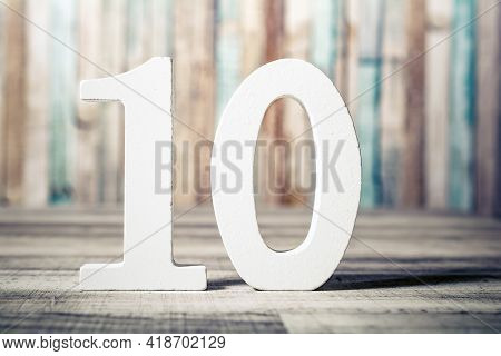 Number 10 Standing On A Gray Wooden Board