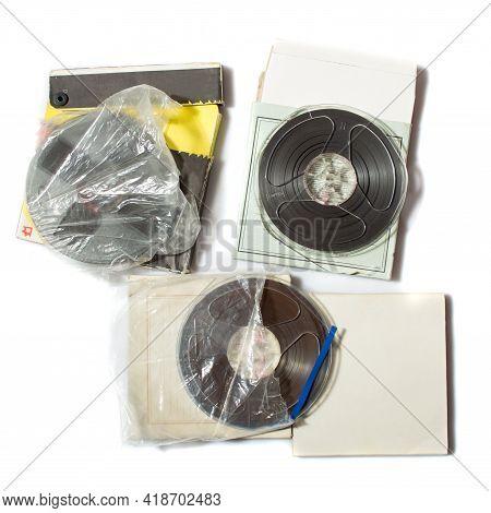 Retro Reel To Reel Tapes On A Carton Box On White Background