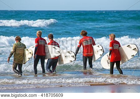 Vale Figueiras, Portugal - October 15, 2020: Surfers getting surf lessons at praia Vale Figueiras in Portugal